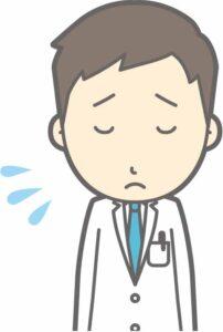 落ち込む男性医師のイラスト